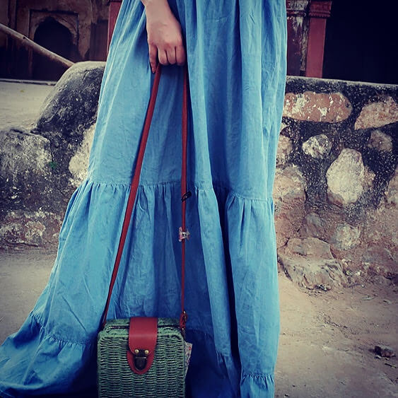 Long flared denim dress with a tote bag