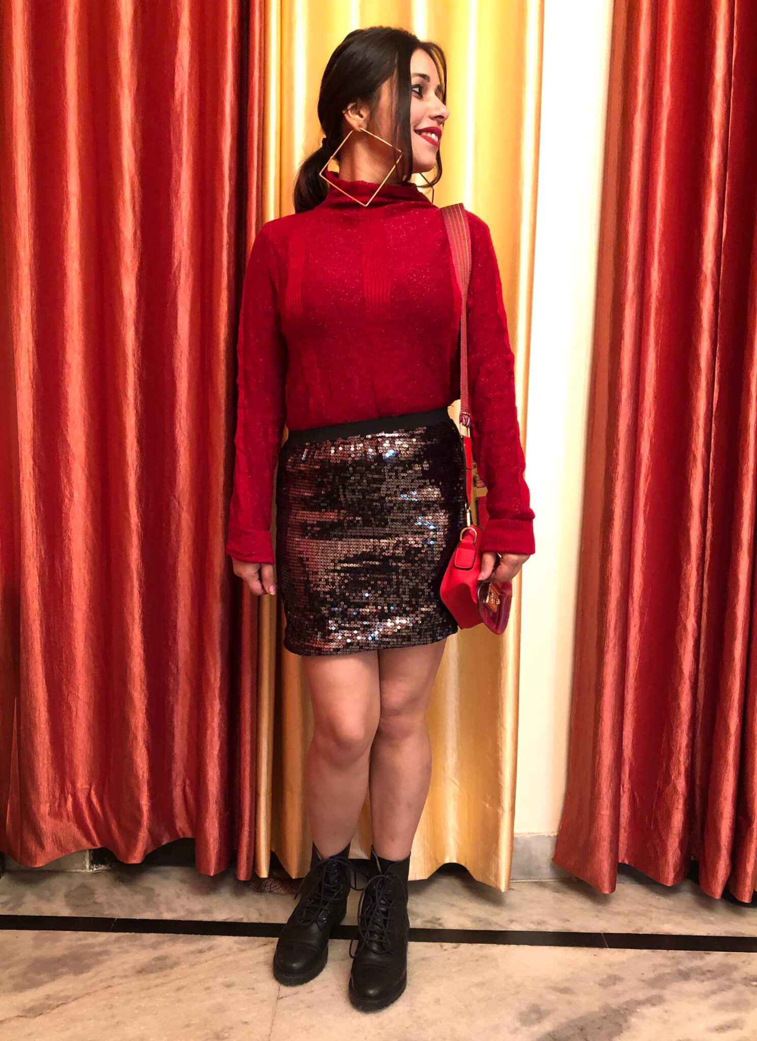 A turtleneck top with a sequin skirt-winter season outfit ideas